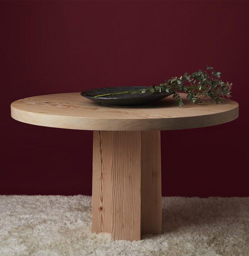 Soma Pedestal with decorative eucalyptus boquet.