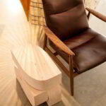 Ikebana: Hikae, used as a side table next to a chair.