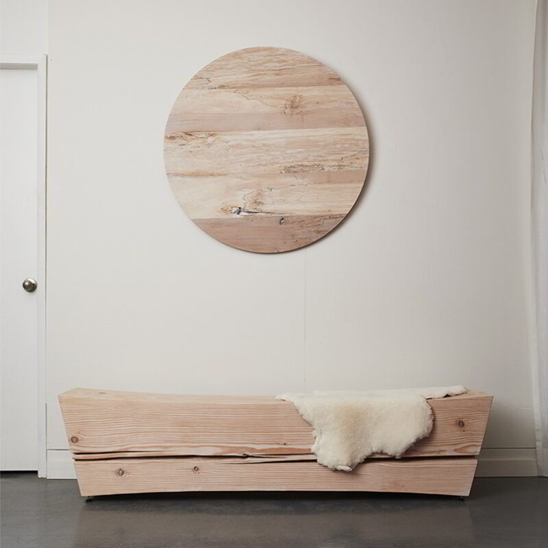 Saddle bench with wall mounted maple platter.