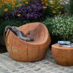 The drum table and nest chair in an outdoor setting.