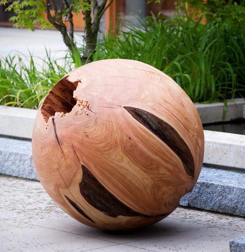 Western red cedar sphere in an outdoor setting.