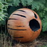 Solid sphere in an outdoor setting.