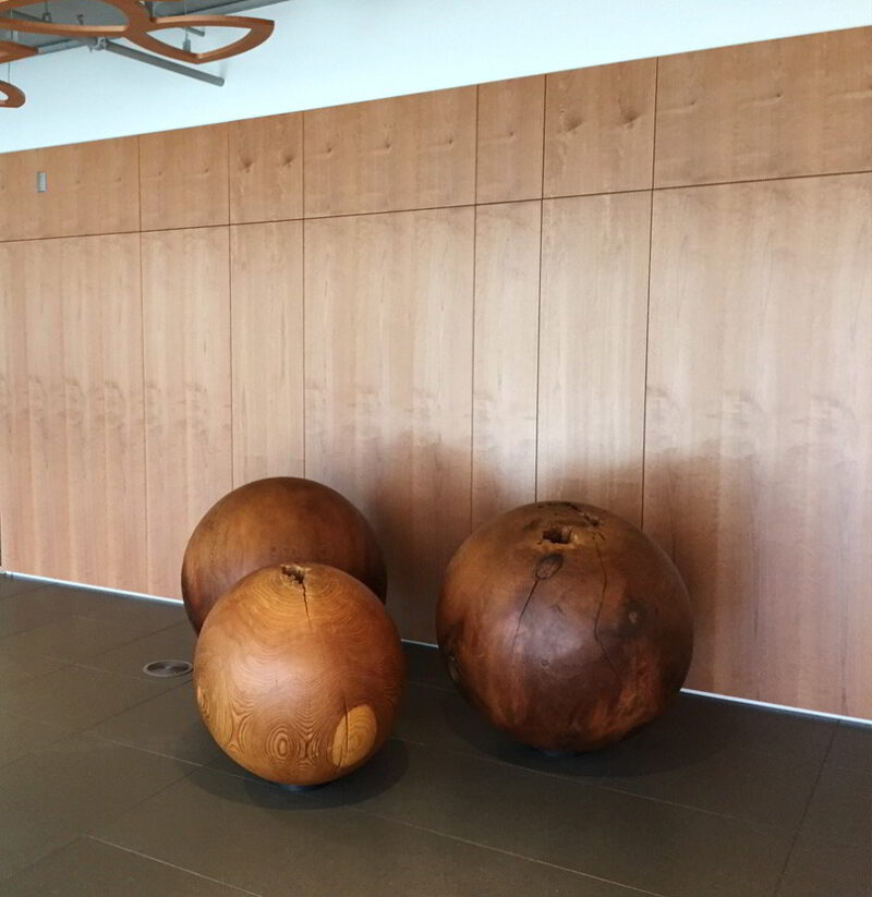 Three solid spheres in a lobby.