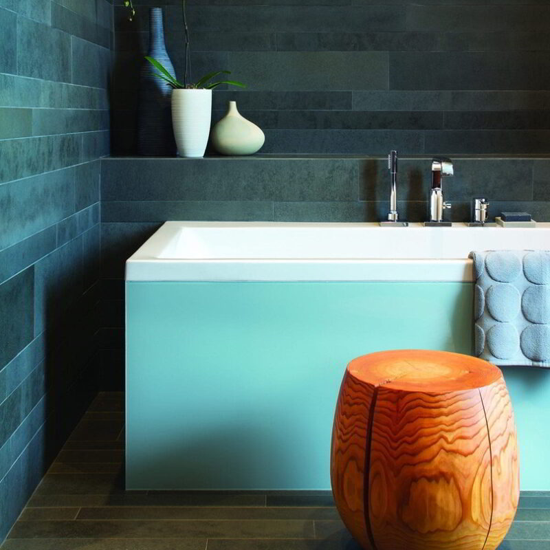 T-cup next to a bathtub.