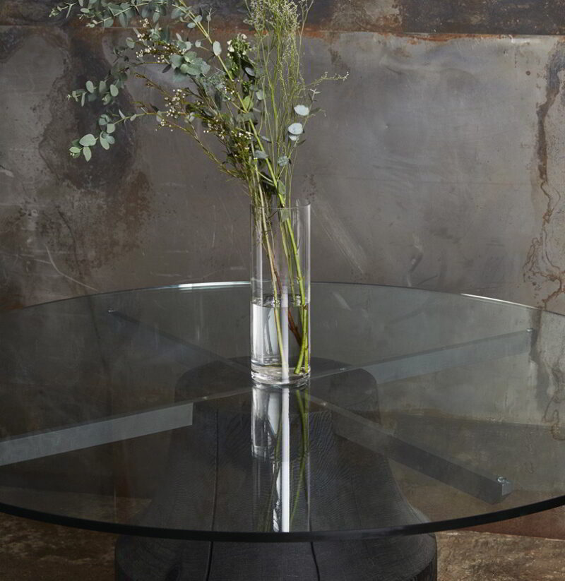Chelsea table with a glass top and scorched base.