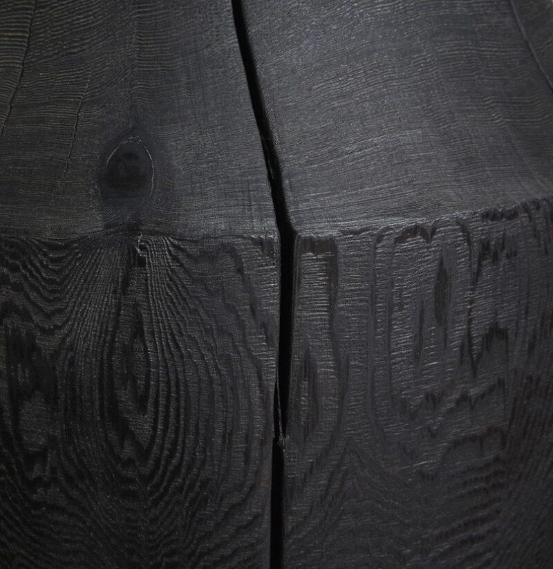 Detail photo of the scorched Western Red Cedar base on the Chelsea table.