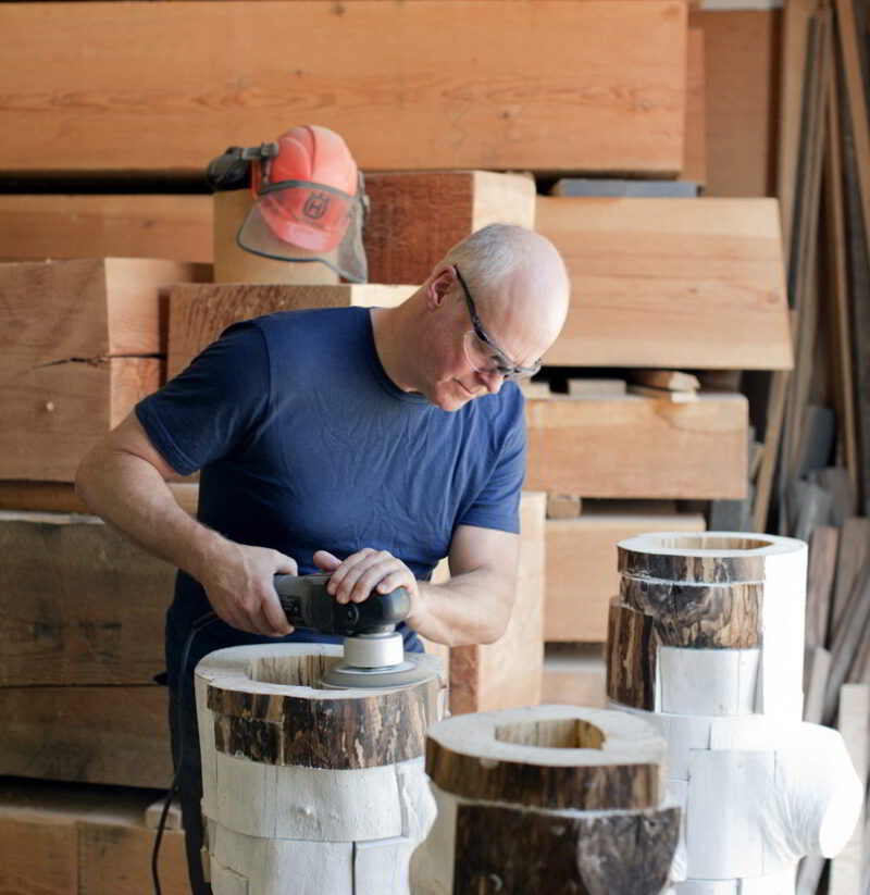 Brent sanding the vessels surface.
