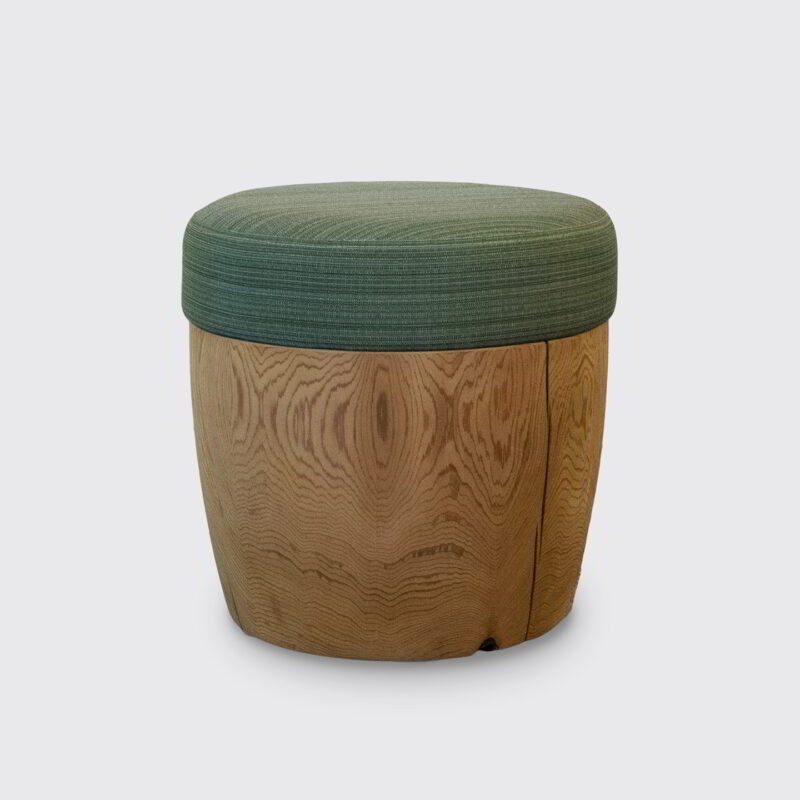 Drum with a green woven pouf.