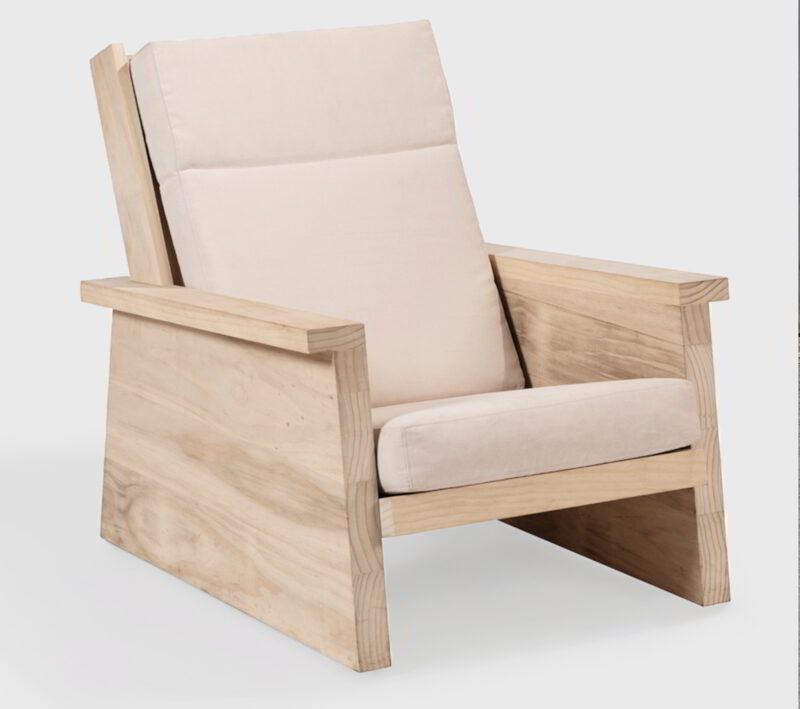 Pesuta chair made from Accoya with white cushions against a white background.
