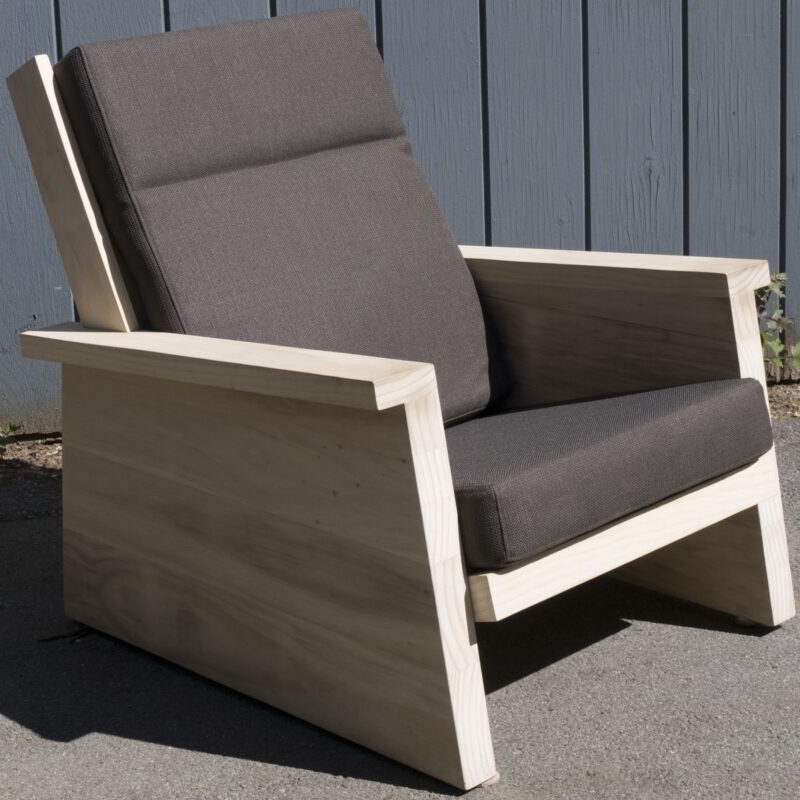 Pesuta chair made from Accoya with black cushions.