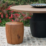 Dr-2 drum and tafoni dining table in an exterior setting.
