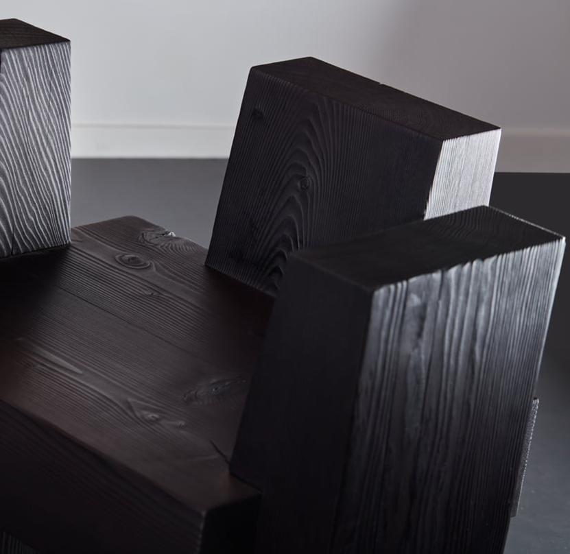 The beton brut chair is pictured in detail in the studio.