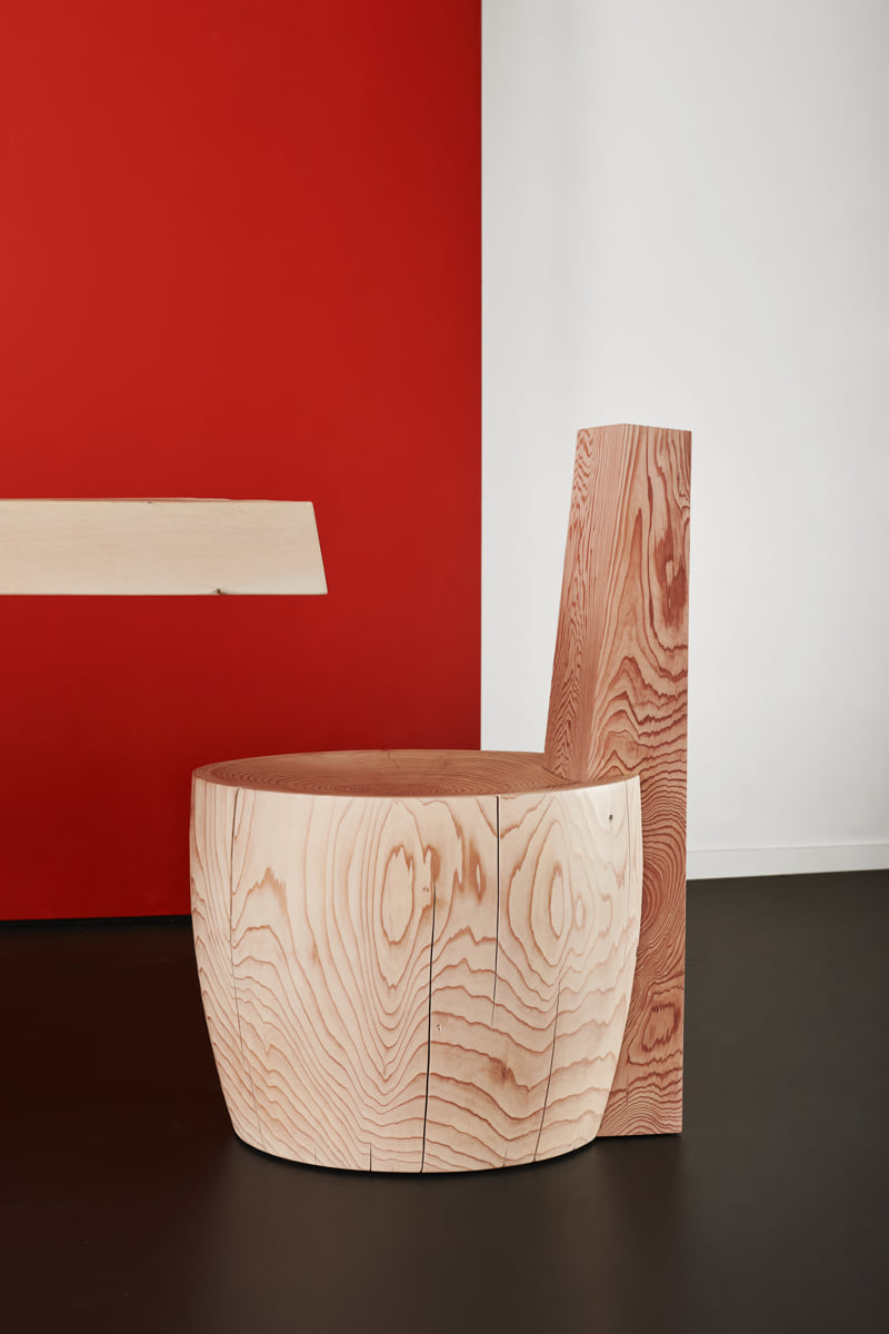 Detailed photo of the Mysa Chair against a red background