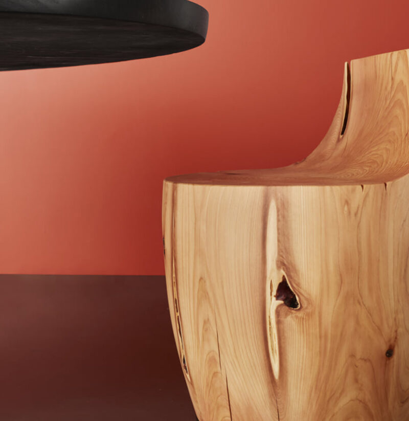 The grain of the Chelsea stool is pictured against a red background.