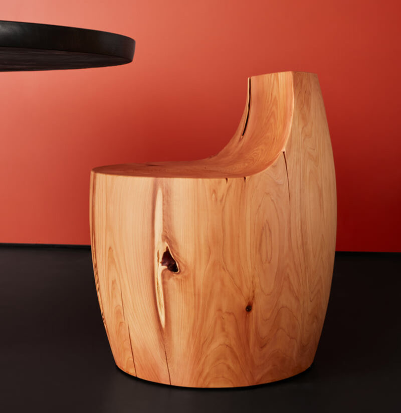 The side profile of the Chelsea stool is pictured against a red background.