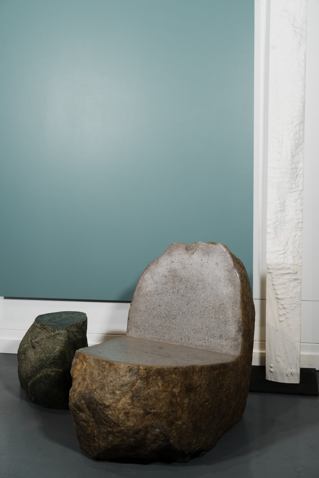 The Ebb chair and Ebb Boulder against a blue background.